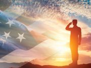 american flag and military personnel